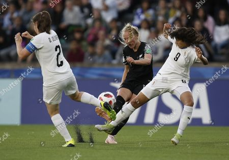 Uruguay's Daniela Olivera (L) and Cecilia Gomez (R) vie for the ball with New Zealand Kelli Brown (C), during their U-17 Women's World Cup soccer match between the national soccer teams of Uruguay and New Zealand, at Charrua stadium in Montevideo, Uruguay, 16 November 2018.