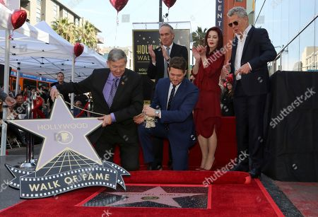 Leron Gubler, Michael Buble, Tom Corson, Priscilla Presely, David Foster. Leron Gubler, from left, Michael Buble, Tom Corson, Priscilla Presely and David Foster unveil a star honoring Buble on the Hollywood Walk of Fame, in Los Angeles
