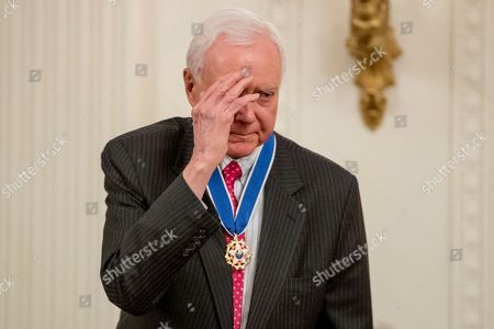 Sen. Orrin Hatch, R-Utah, salutes the audience as he is awarded the Medal of Freedom by President Donald Trump during a ceremony in the East Room of the White House in Washington