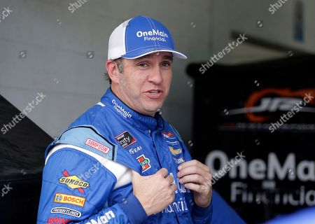 Stock Image of Elliott Sadler stands in the garage during practice for the NASCAR Xfinity series auto race at the Homestead-Miami Speedway, in Homestead, Fla