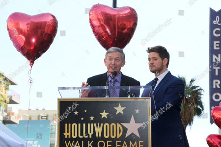 Michael Buble, Leron Gubler. Leron Gubler, left, and Michael Buble speak at the ceremony honoring Michasel Buble with a star at the Hollywood Walk of Fame, in Los Angeles