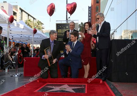 Leron Gubler, Michael Buble, Tom Corson, Priscilla Presley, David Foster. Leron Gubler, left, gives Michael Buble a star miniature as Tom Corson, Priscilla Presley and David Foster applaud moments after unveiling the star at the ceremony honoring Michael Buble with a star at the Hollywood Walk of Fame, in Los Angeles