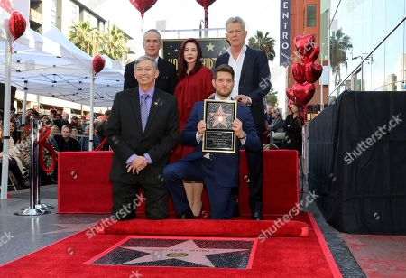 Leron Gubler, Michael Buble, Tom Corson, Priscilla Presley, David Foster. Leron Gubler, from left, Tom Corson, Michael Buble, Priscilla Presley and David Foster pose with a miniature moments after unveiling the star at the ceremony honoring Michael Buble with a star at the Hollywood Walk of Fame, in Los Angeles