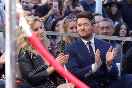 Michael Buble, Luisana Lopilato. Michael Buble, right and his wife actress Luisana Lopilato applaud at the ceremony honoring Michael Buble with a star at the Hollywood Walk of Fame, in Los Angeles