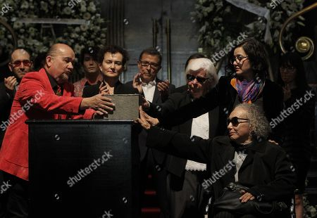 Stock Picture of Widow of Mexican writer Fernando del Paso, Socorro Gordillo (R, down), touches the urn during a posthumous tribute to her husband at the Palace of Belle Arts, in Mexico City, Mexico, 16 November 2018. The Cervantes 2015 laureate passed away on 14 November at the age of 83.