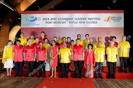 (Front row L-R) Akie Abe and her husband Japan Prime Minister Shinzo Abe, US Vice President Mike Pence, Brunei Darussalam King Sultan Haji Hassanal Bolkiah Mu'izzaddin Adoula, Lynda May Babao and her husband Papua New Guinea's Prime Minister Peter O'Neill, Chinese President Xi Jinping, Hasmah Ali and her husband Malaysian Prime Minister Mahathir Mohamad, Chilean President Sebastian Pinera and (center row, L-R) South Korean President Moon Jae-in with his wife Kim Jung-sook, New Zealand Prime Minister Jacinda Ardern, Indonesian President Joko Widodo with his wife Iriana, Russian Prime Minister Dmitry Medvedev, and (back row, L-R) Mexican Vice-Minister for Foreign Trade, Juan Carlos Baker, Peruvian Foreign Minister Nestor Popolizio, Canada Prime Minister Justin Trudeau, Taiwan representative Morris Chang and his wife Sophie Chang, Vietnam Prime Minister Nguyen Xuan Phuc, Chief Executive of Hong Kong China Carrie Lam and Singapore's Prime Minister Lee Hsien Loong pose for a 'family' photograph during the Asia-Pacific Economic Cooperation (APEC) summit Gala Dinner at the Hilton Hotel in Port Moresby, Papua New Guinea, 17 November 2018. The Asia-Pacific Economic Cooperation (APEC) summit brings together world leaders from its 21 Pacific Rim member nations and is being hosted for the first time by Papua New Guinea.