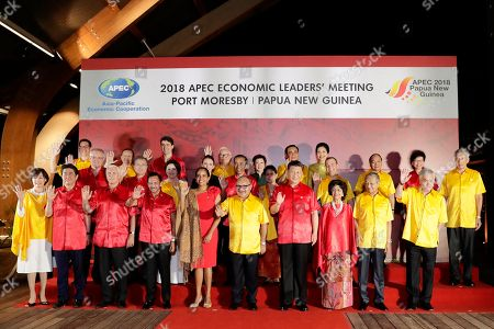 (Front row L-R) Akie Abe and her husband Japan Prime Minister Shinzo Abe, US Vice President Mike Pence, Brunei Darussalam King Sultan Haji Hassanal Bolkiah Mu'izzaddin Adoula, Lynda May Babao and her husband Papua New Guinea's Prime Minister Peter O'Neill, Chinese President Xi Jinping, Hasmah Ali and her husband Malaysian Prime Minister Mahathir Mohamad, Chilean President Sebastian Pinera and (center row, L-R) Australian Prime Minister Scott Morrison, South Korean President Moon Jae-in with his wife Kim Jung-sook, New Zealand Prime Minister Jacinda Ardern, Indonesian President Joko Widodo with his wife Iriana, Russian Prime Minister Dmitry Medvedev, Singapore's Prime Minister Lee Hsien Loong and (back row, L-R) Mexican Vice-Minister for Foreign Trade, Juan Carlos Baker, Peruvian Foreign Minister Nestor Popolizio, Canada Prime Minister Justin Trudeau, Taiwan representative Morris Chang and his wife Sophie Chang, Thai Prime Minster Prayut Chan-o-cha and his wife Naraporn Chan-ocha, Vietnam Prime Minister Nguyen Xuan Phuc and Chief Executive of Hong Kong China Carrie Lam pose for a 'family' photograph during the Asia-Pacific Economic Cooperation (APEC) summit Gala Dinner at the Hilton Hotel in Port Moresby, Papua New Guinea, 17 November 2018. The Asia-Pacific Economic Cooperation (APEC) summit brings together world leaders from its 21 Pacific Rim member nations and is being hosted for the first time by Papua New Guinea.