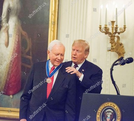 President Donald Trump presents the Medal of Freedom, the highest civilian award presented by the White House in a ceremony in the East Room of the White House to Sen Orrin Hatch.