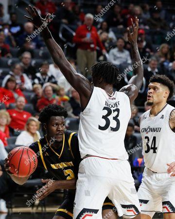 Bobby Arthur-Williams, Nysier Brooks. Milwaukee's Bobby Arthur-Williams (2) passes around Cincinnati's Nysier Brooks (33) in the second half of an NCAA college basketball game, in Cincinnati