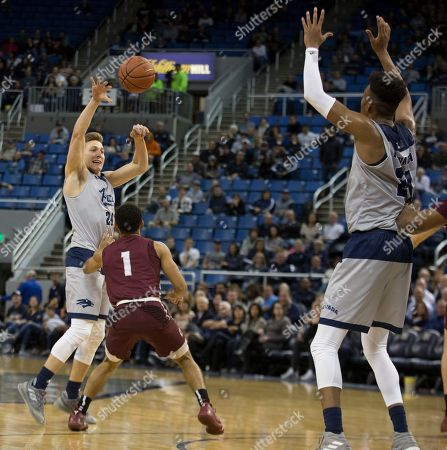 Nevada guard David Cunningham (20) pass the ball against Little Rock in the second half of an NCAA college basketball game in Reno, Nev