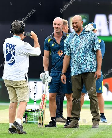 Stock Image of Australian batsman Chris Lynn (C) poses for a photograph with former Australian cricketer Andrew Symonds (R) prior to the T20 International match between Australia and South Africa at Metricon Stadium on the Gold Coast, Australia, 17 November 2018.