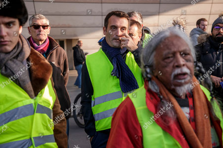 President of French political movement 'Les Patriotes' Florian Philippot (C) wearing a Yellow vest, as a symbol of French driver's and citizen's protest against higher fuel prices, attend a gathering as part of a nationwide protest to block roads and cause traffic chaos, in Paris, France, 17 November 2018. The so-called 'gilets jaunes' (yellow vests) protest movement, which has reportedly no political affiliation, is protesting over fuel prices.