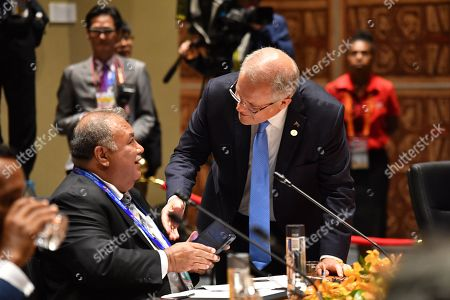 Australia's Prime Minister Scott Morrison (R) greets Nauru's President Baron Waqa (L) at a Pacific Island Countries forum during the Asia-Pacific Economic Cooperation (APEC) summit in Port Moresby, Papua New Guinea, 18 November 2018. The APEC summit brings together world leaders from its 21 member nations and is being hosted for the first time by Papua New Guinea.