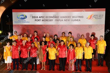 Stock Photo of (Front row, L-R) Akie Abe and her husband Japan Prime Minister Shinzo Abe, US Vice President Mike Pence, Brunei Darussalam King Sultan Haji Hassanal Bolkiah Mu'izzaddin Adoula, Lynda May Babao and her husband Papua New Guinea's Prime Minister Peter O'Neill, Chinese President Xi Jinping, Hasmah Ali and her husband Malaysian Prime Minister Mahathir Mohamad, Chilean President Sebastian Pinera and (center row, L-R) Australian Prime Minister Scott Morrison, South Korean President Moon Jae-in with his wife Kim Jung-sook, New Zealand Prime Minister Jacinda Ardern, Indonesian President Joko Widodo with his wife Iriana, Russian Prime Minister Dmitry Medvedev, Singapore's Prime Minister Lee Hsien Loong and (back row, L-R) Mexican Vice-Minister for Foreign Trade, Juan Carlos Baker, Peruvian Foreign Minister Nestor Popolizio, Canada Prime Minister Justin Trudeau, Taiwan representative Morris Chang and his wife Sophie Chang, Thai Prime Minster Prayut Chan-o-cha and his wife Naraporn Chan-ocha, Vietnam Prime Minister Nguyen Xuan Phuc and Chief Executive of Hong Kong China Carrie Lam pose for a 'family' photograph during the Asia-Pacific Economic Cooperation (APEC) summit Gala Dinner at the Hilton Hotel in Port Moresby, Papua New Guinea, 17 November 2018. The Asia-Pacific Economic Cooperation (APEC) summit brings together world leaders from its 21 Pacific Rim member nations and is being hosted for the first time by Papua New Guinea.