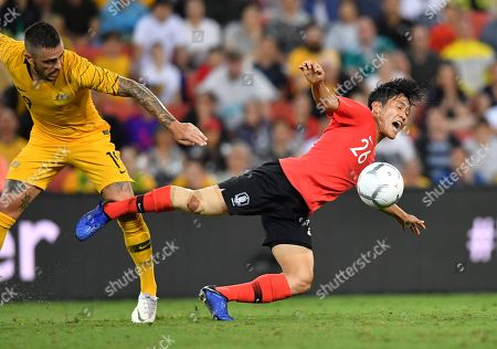 Josh Risdon (left) of the Socceroos in action against Na Sangho (right) of Korea Republic during the International friendly match between Australia and the Korea Republic at Suncorp Stadium, in Brisbane, Australia, 17 November 2018.