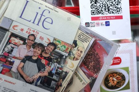 Newspaper clippings showing Li Ruifang (2-L) flanked by her father Lee Wong Leong (L) and mother Goh Kwee Lee (3-L) and the late celebrity chef Anthony Bourdain are displayed on the storefront of the 545 Whampoa Prawn Noodle stall at the Tekka Market in Singapore, 11 November 2018. The stall was opened by 33-year-old Li Ruifang, who left her corporate job in order to take on and continue the family tradition of hawker of her parents and grandparents using the family prawn noodle recipe. Singapore announced in August that it would be nominating its hawker culture, comprising over 6000 hawkers, for a Unesco's Representative List of the Intangible Cultural Heritage of Humanity. Hawker centers were started in the 1970s by moving street vendors into purpose built facilities. There are over 110 such hawker centers in the country. Street food in Asia is a bit of everything that delights the palate and comes at a good price. It is colorful, tasty and varied; sometimes sharp, saucy or spicy. There is something for the sweet tooth, or to suit those looking more for a savory sensation. Drinks and snacks and full meals.