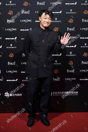 Stock Photo of Hong Kong singer Eason Chan poses on the red carpet at the 55th Golden Horse Awards in Taipei, Taiwan, . Chan is the guest at this year's Golden Horse Awards, one of the Chinese-language film industry's biggest annual events