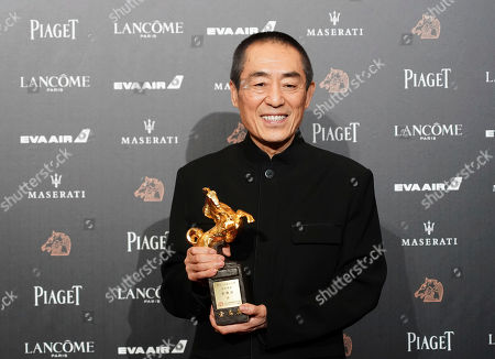 """Chinese director Zhang Yimou holds his award for Best Director at the 55th Golden Horse Awards in Taipei, Taiwan, . Zhang won for the film """"Shadow"""" at this year's Golden Horse Awards -the Chinese-language film industry's biggest annual events"""
