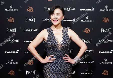 Hong Kong actress Carina Lau poses on the red carpet at the 55th Golden Horse Awards in Taipei, Taiwan, . Lau is the guest at this year's Golden Horse Awards, one of the Chinese-language film industry's biggest annual events