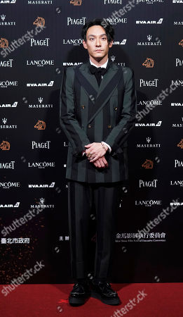 Stock Photo of Taiwanese actor Chang Chen poses on the red carpet at the 55th Golden Horse Awards in Taipei, Taiwan, . Chang is the guest at this year's Golden Horse Awards, one of the Chinese-language film industry's biggest annual events
