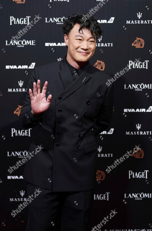 Stock Picture of Hong Kong singer Eason Chan poses on the red carpet at the 55th Golden Horse Awards in Taipei, Taiwan, . Chan is the guest at this year's Golden Horse Awards, one of the Chinese-language film industry's biggest annual events