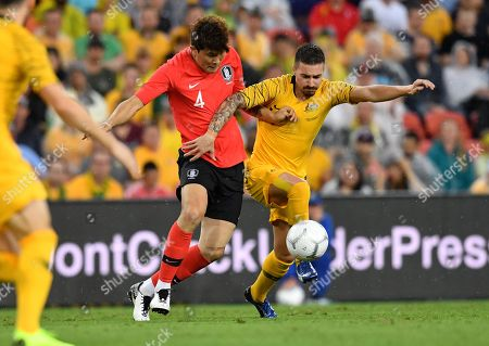Kim Minjae (left) of Korea Republic takes on Jamie Maclaren (right) of the Socceroos during the international friendly match between Australia and South Korea at Suncorp Stadium in Brisbane, Australia, 17 November 2018.
