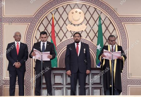 Stock Photo of Maldives' Chief Justice Dr Ahmed Abdulla Didi, right, administers the oath of office to Vice President Faisal Naseem, second left, with new President Ibrahim Mohamed Solih, left, and Speaker Qasim Ibrahim standing beside them in Male, Maldives, . Thousands of people cheered Solih, from the Maldivian Democratic Party, at a swearing-in ceremony Saturday in a soccer stadium chosen to accommodate a large number of his supporters