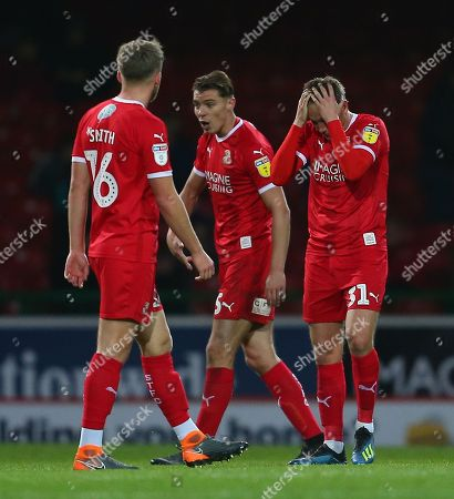 Matthew Taylor of Swindon  and  Sid Nelson of Swindon  dejected after conceding a goal