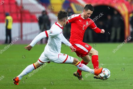 Montenegro's Marko Vesovic (L) in action against Serbia's Antonio Rukavina (R) during the UEFA Nations League soccer match between Serbia and Montenegro in Belgrade, Serbia, 17 November 2018.
