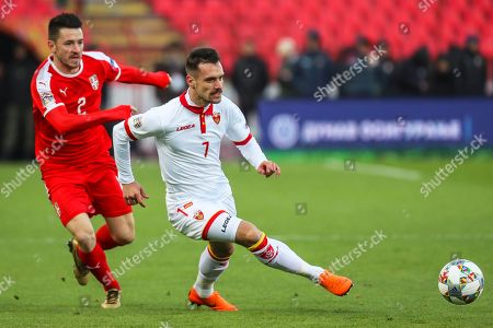 Serbia's Antonio Rukavina (L) in action against Montenegro's Marko Vesovic (R) during the UEFA Nations League soccer match between Serbia and Montenegro in Belgrade, Serbia, 17 November 2018.