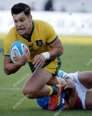 Australia's Matt Toomua, left, is tackled by Italy's Tito Tebald during the rugby union international match between Italy and Australia at the Euganeo Stadium in Padua, Italy
