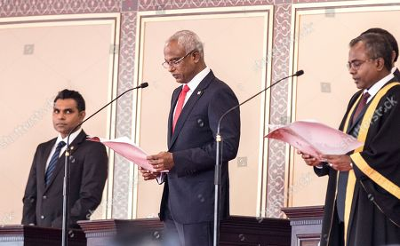 New Maldivian President Ibrahim Mohamed Solih (C) takes his oath during his swearing-in ceremony in Male, Maldives, 17 November 2018. A veteran politician, Ibrahim Mohamed Solih took office on the day as president after successfully ousting former pro-China president Abdulla Yameen.