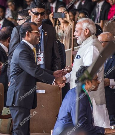 Indian Prime Minister Narendra Modi (R) greets former Maldivian president Mohamed Nasheed (L) as both attend the newly elected Maldivian president Ibrahim Mohamed Solih's swearing-in ceremony in Male, Maldives, 17 November 2018. A veteran politician, Ibrahim Mohamed Solih took office on the day as president after successfully ousting former pro-China president Abdulla Yameen.