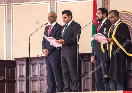 Maldives' Chief Justice Dr Ahmed Abdulla Didi (R) administers the oath of office to Vice President Faisal Naseem (2-L) as new Maldivian President Ibrahim Mohamed Solih (L) and Speaker Qasim Ibrahim look on during their swearing-in ceremony in Male, Maldives, 17 November 2018. A veteran politician, Ibrahim Mohamed Solih took office on the day as president after successfully ousting former pro-China president Abdulla Yameen.