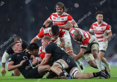 Owen Farrell  and Dylan Hartley of England  tackle