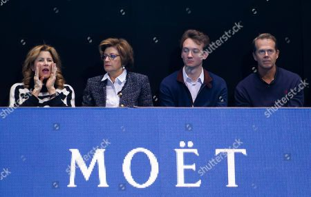 Stock Picture of Mirka Federer (L) wife of Tennis Player Roger Federer sits court side with his Mother Lynette Federer and former Tennis Player Stefan Edberg