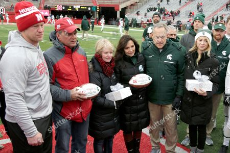 Scott Frost, Gerald Foltz, Jill Foltz, Karen Sadler, Mark Dantonio, Katie Sadler. Nebraska head coach Scott Frost, left, Gerald and Jill Foltz, Karen Sadler, third right, Michigan State head coach Mark Dantonio, second from right, and Katie Sadler, right, participate in a midfield ceremony before an NCAA college football game in Lincoln, Neb., . The ceremony was held to honor former punters Sam Foltz, of Nebraska, and Mike Sadler, of Michigan State, who died in a car accident in July 2016 while both were in Wisconsin to work at a kicking camp. It is the first game between the teams since the accident