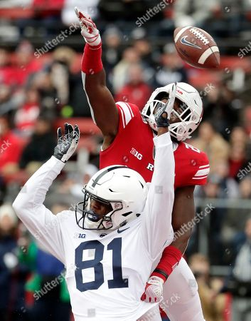 Stock Image of Rutgers defensive back Avery Young, top, tries to deflect a pass from Penn State quarterback Trace McSorley, not pictured, intended for wide receiver Cam Sullivan-Brown during the first half of an NCAA college football game, in Piscataway, N.J. Young was called for a pass interference penalty on the play