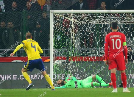 Sweden's Andreas Granqvist, left, scores his side's opening goal during the UEFA Nations League soccer match between Turkey and Sweden in Konya, Turkey