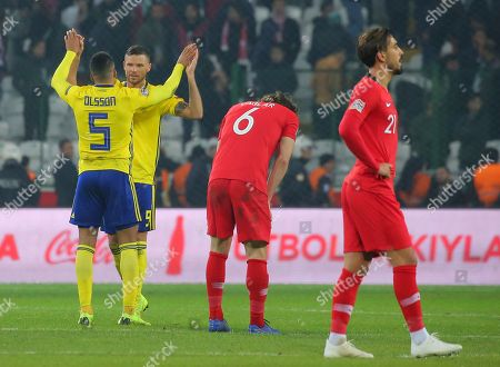 Sweden's Martin Olsson and Sweden's Marcus Berg, left, celebrate their victory after the UEFA Nations League soccer match between Turkey and Sweden in Konya, Turkey