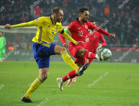 Sweden's Andreas Granqvist, left, and Turkey's Hakan Calhanoglu challenge for the ball during the UEFA Nations League soccer match between Turkey and Sweden in Konya, Turkey