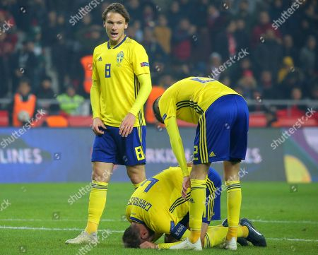 Sweden's Mikazel Lustig, right, comforts Sweden's Andreas Granqvist during the UEFA Nations League soccer match between Turkey and Sweden in Konya, Turkey
