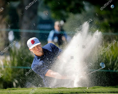 Nick Watney hits out of the bunker on the first green during the third round of the RSM Classic golf tournament, in St. Simons Island, Ga