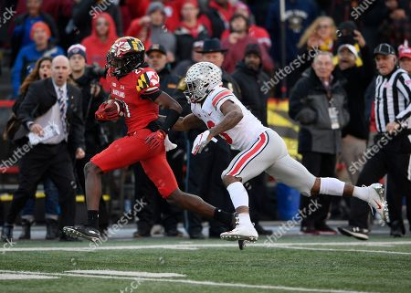 Maryland wide receiver Darryl Jones (21) runs with the ball against Ohio State cornerback Damon Arnette (3) during the second half of an NCAA football game, in College Park, Md. Ohio State won 52-51 in overtime