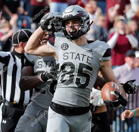 Mississippi State wide receiver Austin Williams (85) salutes after scoring a touchdown against Arkansas in the second half of an NCAA college football game in Starkville, Miss., . Mississippi State won 52-6