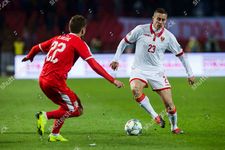 Adam Marusic of Montenegro takes on Adem Ljajic of Serbia