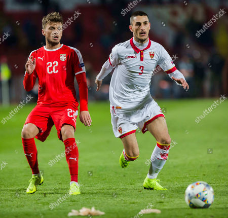 Adem Ljajic of Serbia and Risto Radunovic of Montenegro in action