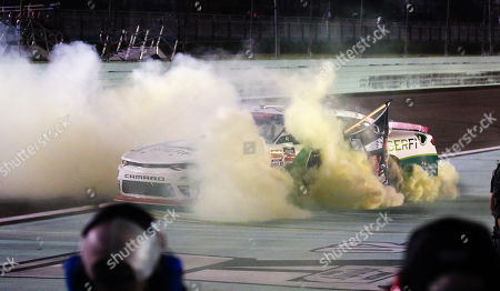 Tyler Reddick, driver of the (9) BurgerFi Chevrolet, celebrates with a burnout after winning the NASCAR XFINITY Series Ford EcoBoost 300 Championship at the Homestead-Miami Speedway in Homestead, Fla