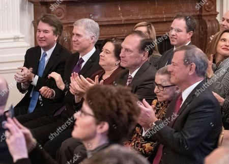 Members of the United States Supreme Court, from left to right, Associate Justice of the Supreme Court Brett Kavanaugh, Associate Justice of the Supreme Court Neil M. Gorsuch, Associate Justice of the Supreme Court Elena Kagan, Associate Justice of the Supreme Court Samuel A. Alito, Jr., Associate Justice of the Supreme Court Ruth Bader Ginsburg, and Chief Justice of the US John G Roberts Jnr, Jr. applaud the arrival of Maureen Scalia who will accept the Presidential Medal of Freedom for her late husband, the late Associate Justice of the Supreme Court Antonin Scalia prior to President Trump awarding the medal during a ceremony in the East Room of the White House in Washington, DC. The award is the nation's highest civilian honor and is awarded by the President to individuals who made meritorious contributions to the United States.