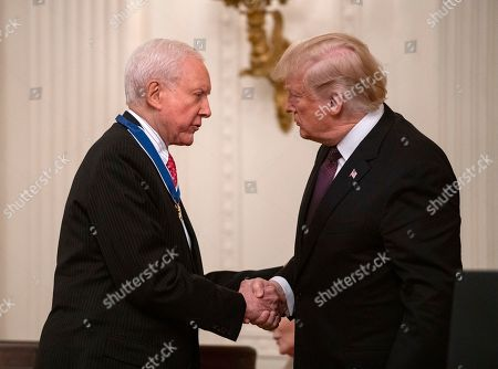 United States President Donald Trump, right, shaking hands with US Senator Orrin Hatch (Republican of Utah), left, after awarding him the Presidential Medal of Freedom to during a ceremony in the East Room of the White House in Washington, DC. The award is the nation's highest civilian honor and is awarded by the President to individuals who made meritorious contributions to the United States.